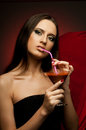 Beautiful girl the very pretty woman vamp with glass and blood sensual sexuality gaze Royalty Free Stock Photography