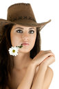 Beautiful girl the very pretty woman on white background in cowboy hat with camomile sensual sexuality gaze isolated Stock Photography