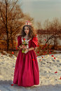 Beautiful girl in vintage red dress with a rose Royalty Free Stock Photo