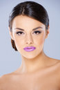 Beautiful girl with violet lips looking stight into camera Stock Image