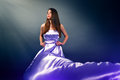 Beautiful girl violet long dress black background Royalty Free Stock Photos