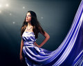 Beautiful girl violet long dress black background Royalty Free Stock Photo