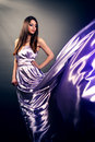 Beautiful girl violet long dress black background Stock Photography