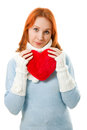 Beautiful girl in warm clothes with a heart Stock Photography