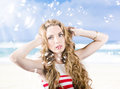 Beautiful girl wearing summer make up on beach close portrait of a with wind fluttering in her long wavy hair style Stock Photo