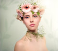 Beautiful girl wearing wreath of flowers on light background Royalty Free Stock Photo