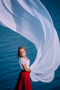 Beautiful Girl With White fabric on sea background Royalty Free Stock Photo