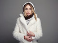 Beautiful girl in white fur coat and hood. winter fashion Royalty Free Stock Photo