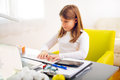 Beautiful girl working on her school project at home Royalty Free Stock Photo