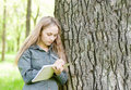 Beautiful girl writes on nature Royalty Free Stock Photo