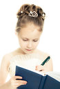 Beautiful girl writing in a notebook on a white background Royalty Free Stock Photos