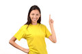 Beautiful girl with yellow t shirt pointing up young woman signing isolated on white Stock Photos