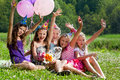 Beautiful girls celebrate birthday outdoors Stock Photos