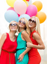 Beautiful girls with colorful balloons in the city holidays and tourism friends hen party blonde concept three women Stock Photos