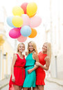 Beautiful girls with colorful balloons in the city holidays and tourism friends hen party blonde concept three women Royalty Free Stock Images