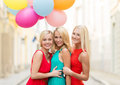 Beautiful girls with colorful balloons in the city holidays and tourism friends hen party blonde concept three women Royalty Free Stock Photography