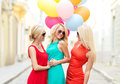 Beautiful girls with colorful balloons in the city holidays and tourism friends hen party blonde concept three women Stock Image