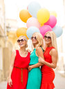 Beautiful girls with colorful balloons in the city holidays and tourism friends hen party blonde concept three women Stock Photography