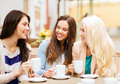 Beautiful girls drinking coffee in cafe holidays and tourism concept Royalty Free Stock Image
