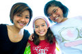 Beautiful girls from a family in group hug. Royalty Free Stock Photography
