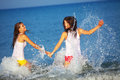 Beautiful girls having fun water beach Stock Images