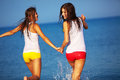 Beautiful girls having fun water beach Stock Photography