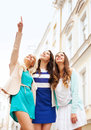 Beautiful girls looking at something in the city holidays and tourism concept Stock Photography