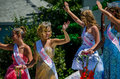 Beautiful girls in a parade wave from atop float during the coloma peach festival michigan usa Stock Photography
