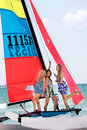 Beautiful girls on sea catamaran Stock Photo