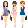 Beautiful girls shopping three young in summer mini dresses happy walking carrying bags Royalty Free Stock Photo
