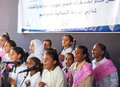 Beautiful girls singing coral song in arabic group of choir hejab and jeans at charity event related usaid at a camp to help Stock Photography