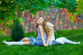 Beautiful girls sisters enjoying colorful nature outdoors Stock Photo