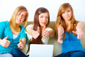 Beautiful girls thumbs up with laptop Royalty Free Stock Images
