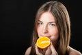 Beautiful glad woman and fresh juicy orange close up portrait of Royalty Free Stock Image