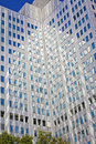 Beautiful glass office building with blue reflecti Royalty Free Stock Photos