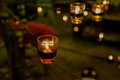 Beautiful glassy candle holders on stand Royalty Free Stock Photo