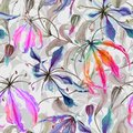 Beautiful gloriosa lily flowers with climbing leaves on gray background. Seamless floral pattern. Watercolor painting.