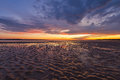 Beautiful glowing sunset reflections in sand ripples, Inverloch, Royalty Free Stock Photo
