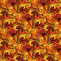 Beautiful golden orange and red peacock feathers, seamless pattern background. Royalty Free Stock Photo