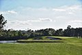 Beautiful golf hole fairway shot of a in florida with the green surrounded by water and landscape Stock Images