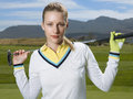 Beautiful golfer with club on golf course portrait of female Stock Image