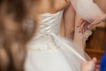 Beautiful gorgeous brunette bride getting ready in the morning w Royalty Free Stock Photo