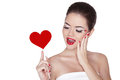 Beautiful gorgeous woman with glamour bright makeup holding red heart isolated on white background manicured nails and lips Stock Images