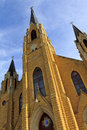 Beautiful gothic style church steeples rise high i these catholic into the blue midwestern sky holy cross catholic in pfeifer Stock Photography