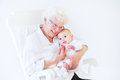 Beautiful grandmother singing to newborn grandson Royalty Free Stock Photo
