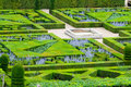 Beautiful green boxwood garden pruned into shapes Stock Photo