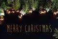 Beautiful green fir and christmas golden vintage garland lights