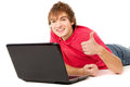 The beautiful guy works for laptop and displays OK Royalty Free Stock Photo