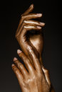 Beautiful hands in golden paint Royalty Free Stock Photo