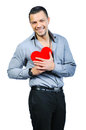 Handsome young macho man holding love heart Royalty Free Stock Photo